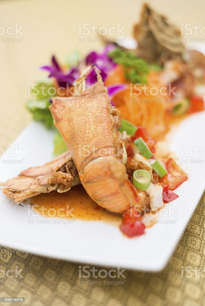 Thai style lobster with chilli sauce stock photo