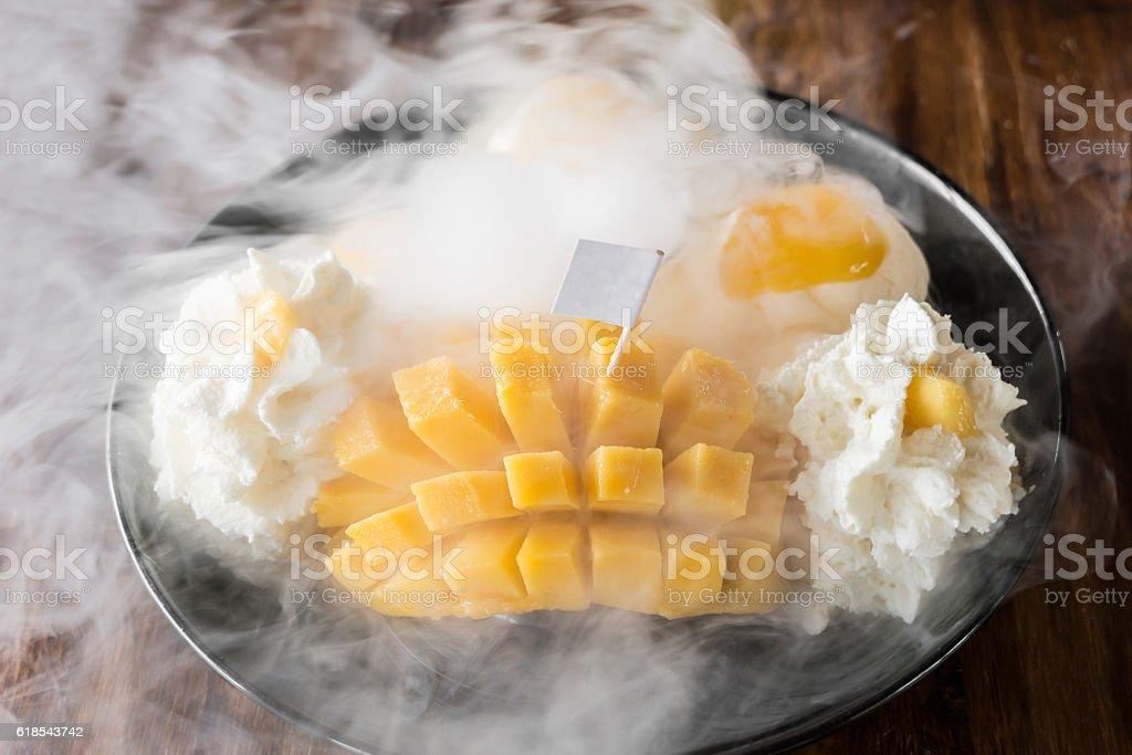 Thai style mango Ice Cream Set and dry ice stock photo
