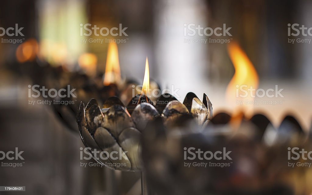 Thai style metal candle in temple royalty-free stock photo