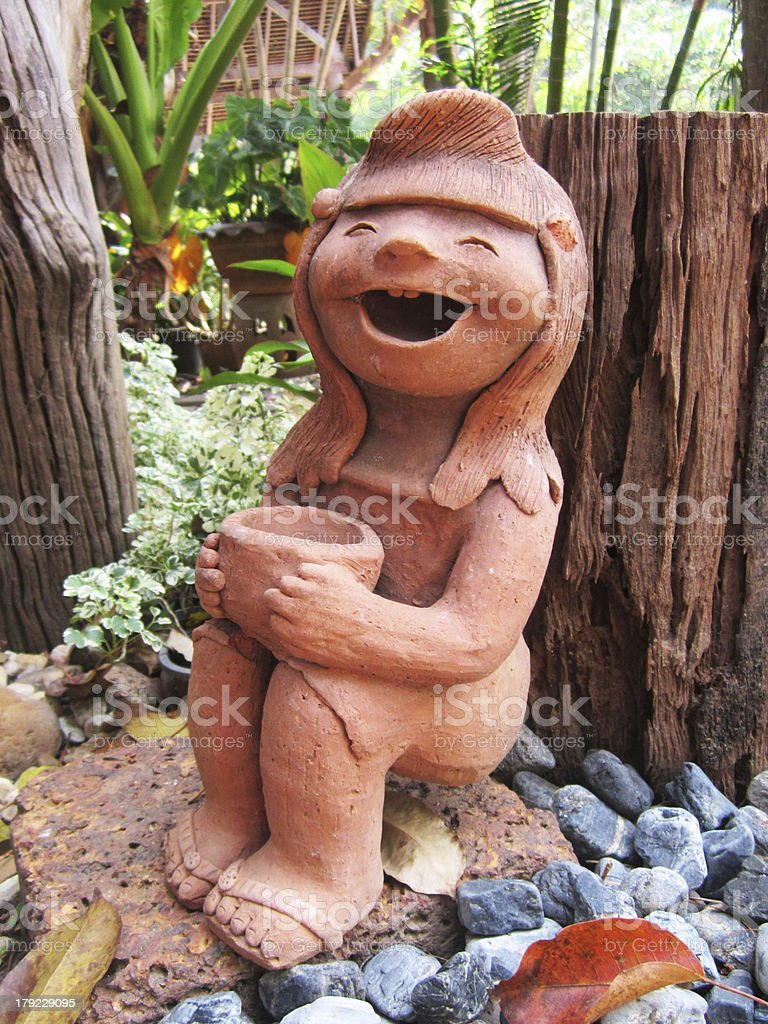 Thai style sculpture doll girl happy. royalty-free stock photo