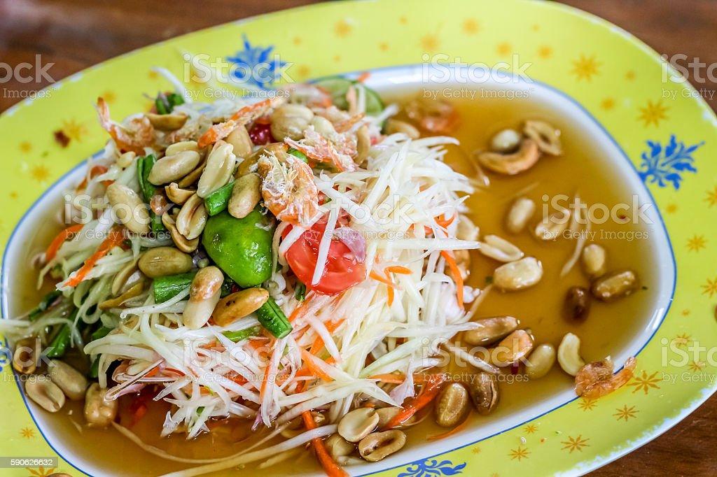 Thai style spicy green papaya salad (som tum Thai) stock photo