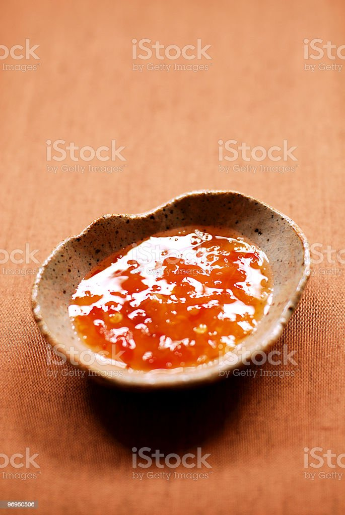 Thai sweet chili sauce in a hand-made earthenware dish royalty-free stock photo