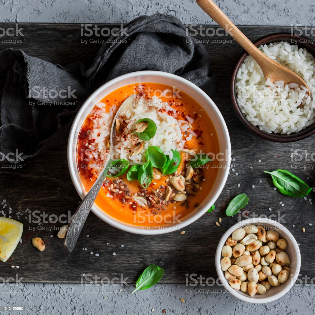 Thai  sweet potato soup with rice on the dark table, top view. stock photo