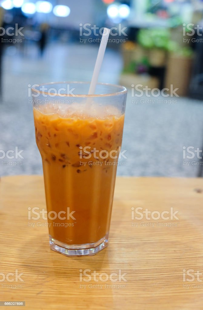 Thai tea 'cha-yen' cold tea' in gladd n countryside coffee shop. stock photo