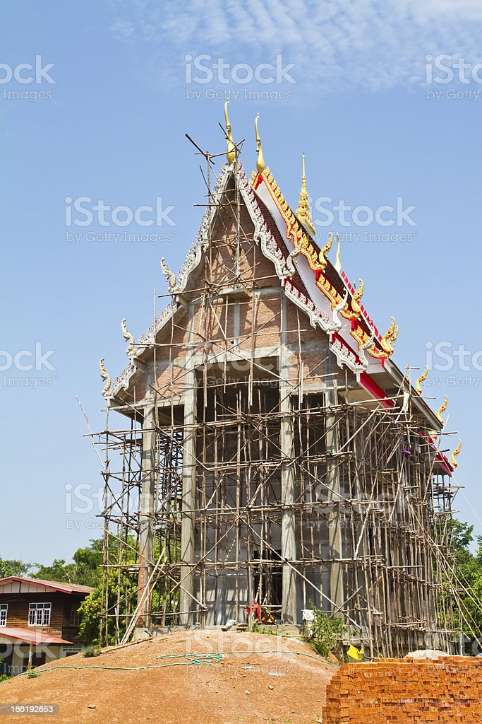 Thai temple and scaffolding under construction royalty-free stock photo