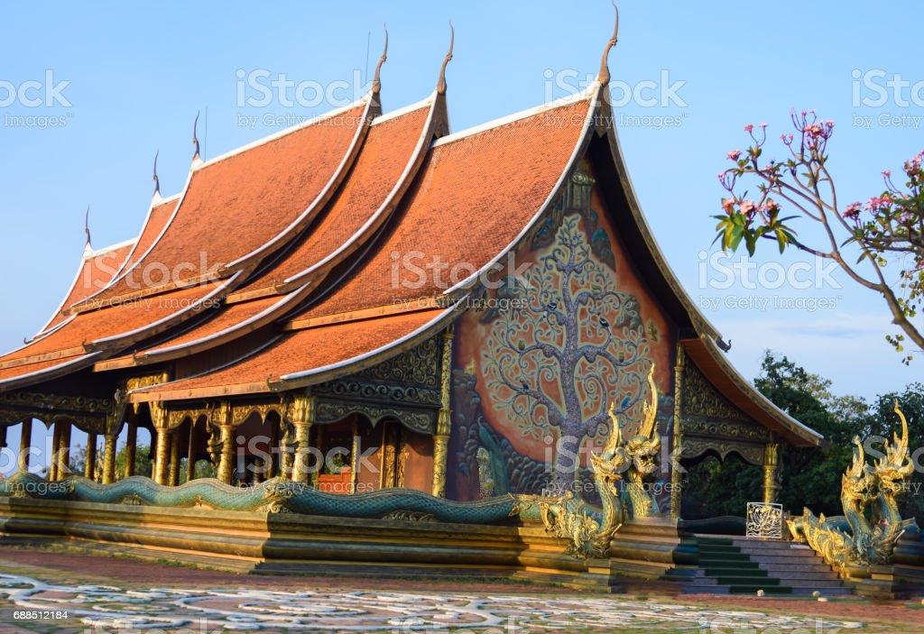 Thai Temple sirindhornwararam (Wat Phu Prao) on blue sky background , public temple in Ubon Ratchathani stock photo