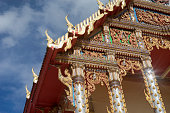 thai temple with blue sky and clouds in background