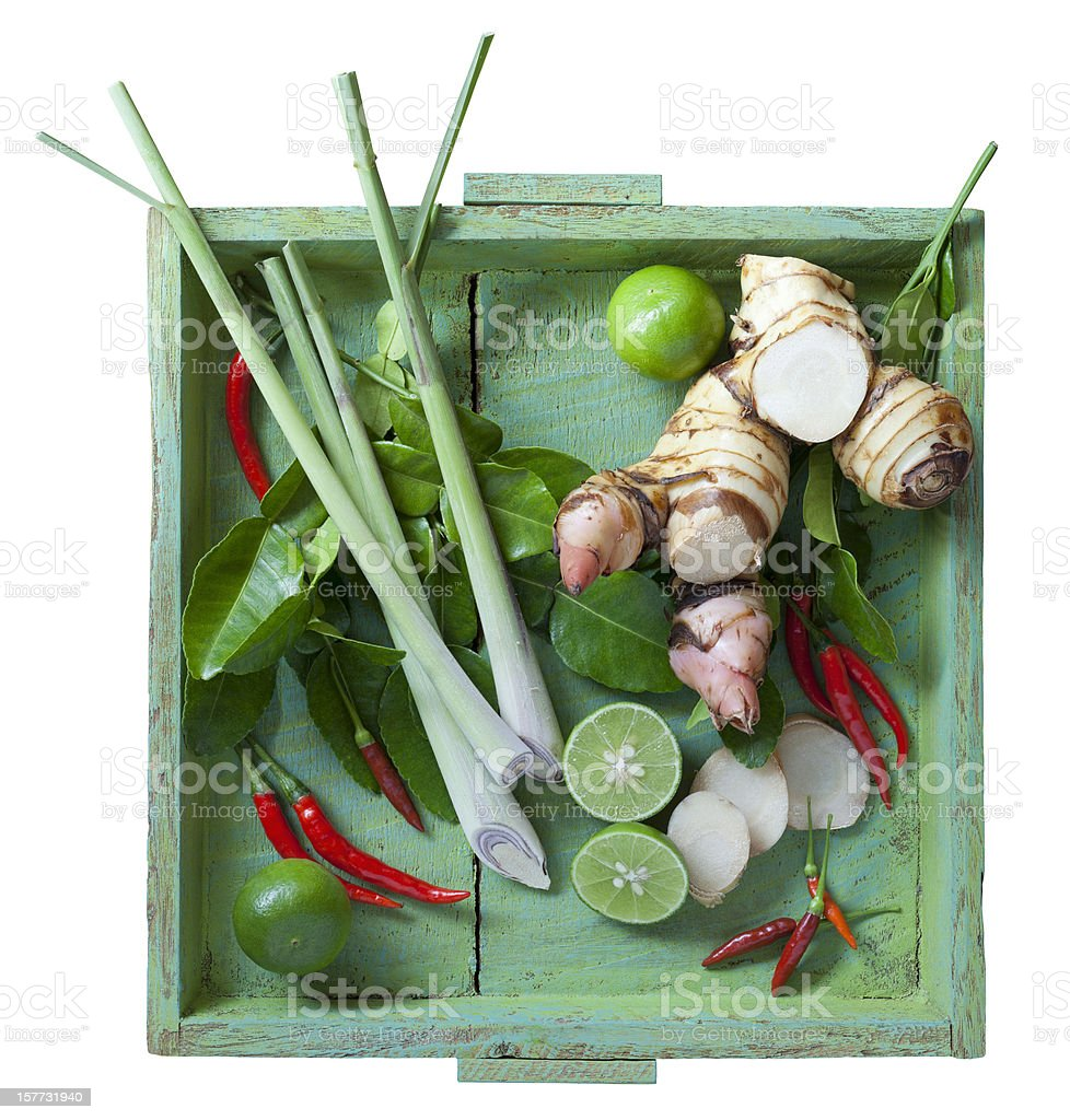 Thai Tom Yam soup herbs on old green wooden tray. stock photo