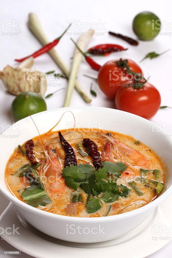 Thai Tom Yum soup dish with prawn and herbs stock photo