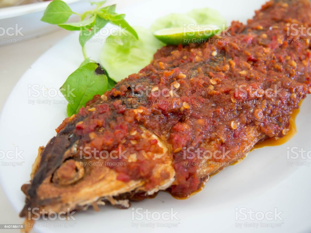 Thai Tradition Food, deep-fried fish topped with fresh herbs and stock photo