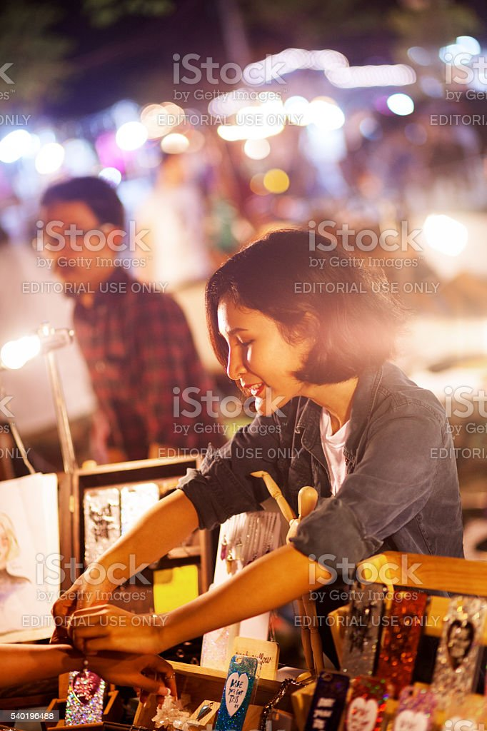 Thai vendor selling bracelet stock photo