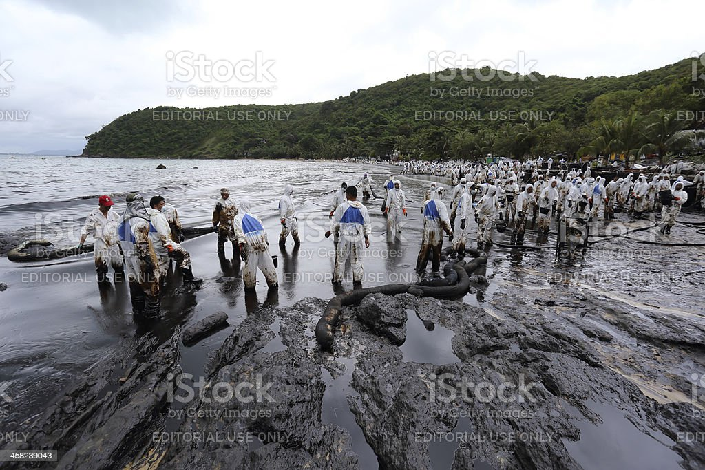 Thai volunteers  have cleaned  oil stains royalty-free stock photo