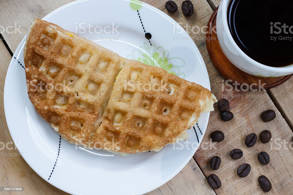 Thai waffle on white dish and coffee, Top view stock photo