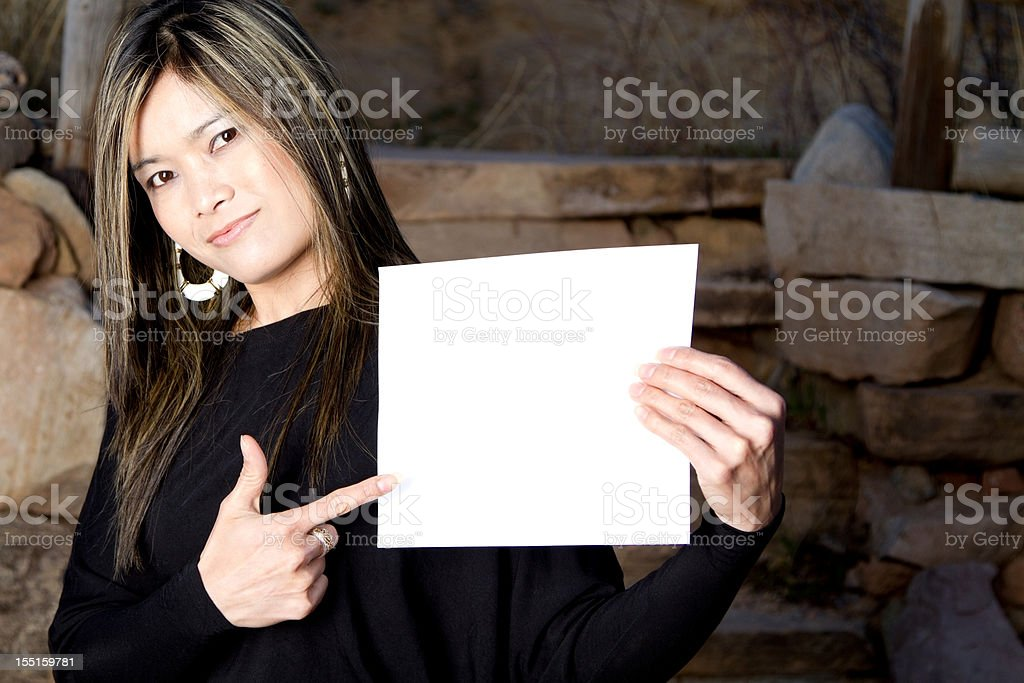 Thai woman pointing at blank sign royalty-free stock photo
