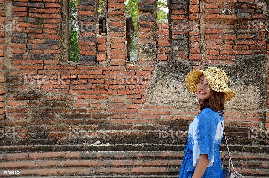 Thai woman portrait at ancient building at Wat Mahathat stock photo