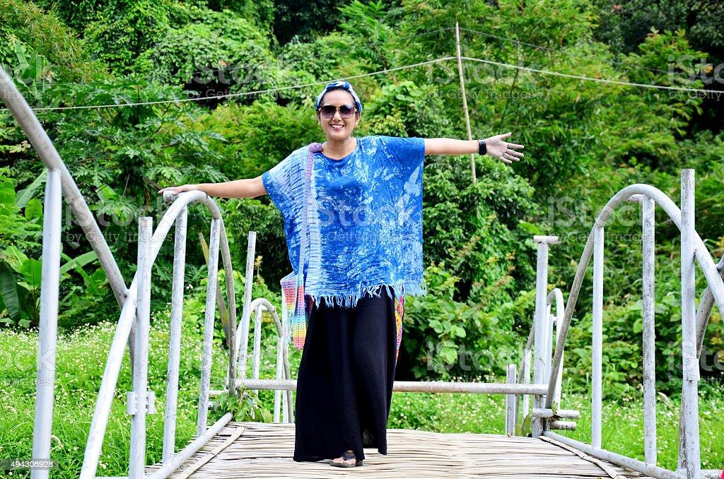 Thai woman portrait on Bamboo bridge at Baan Natong stock photo