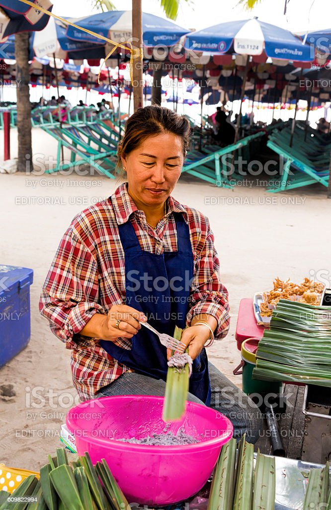 Thai woman preparing sticky rice in banana leaves, Bangsaen, Thailand stock photo