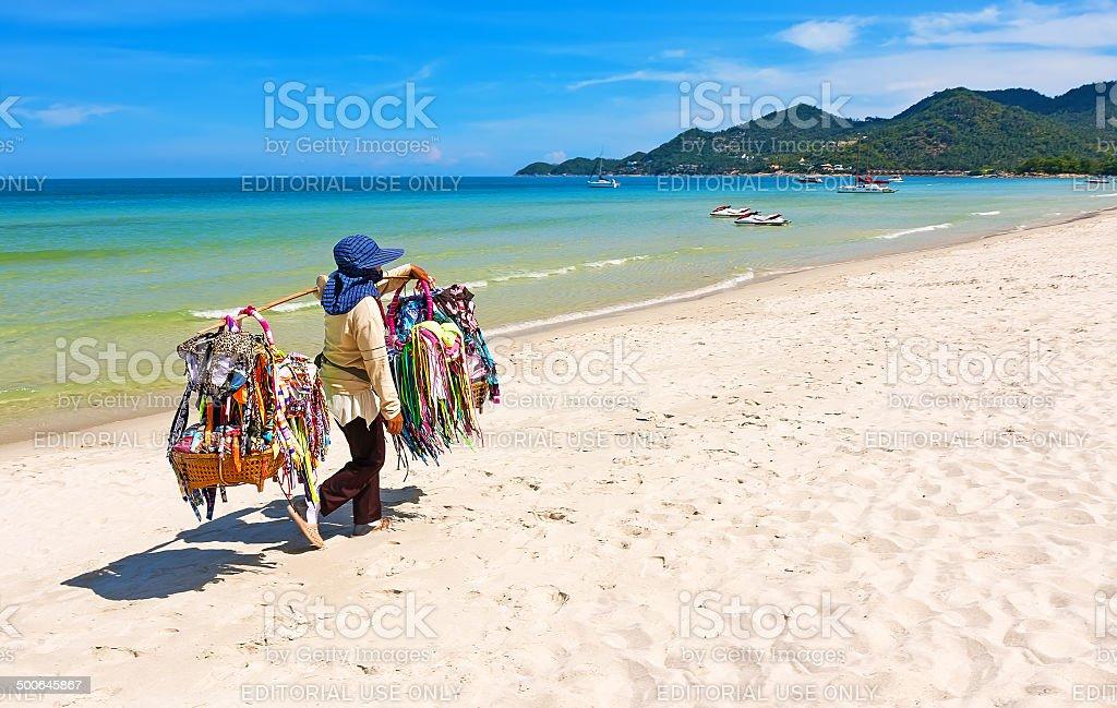 Thai woman selling beachwear at beach in Koh Samui, Thailand. stock photo