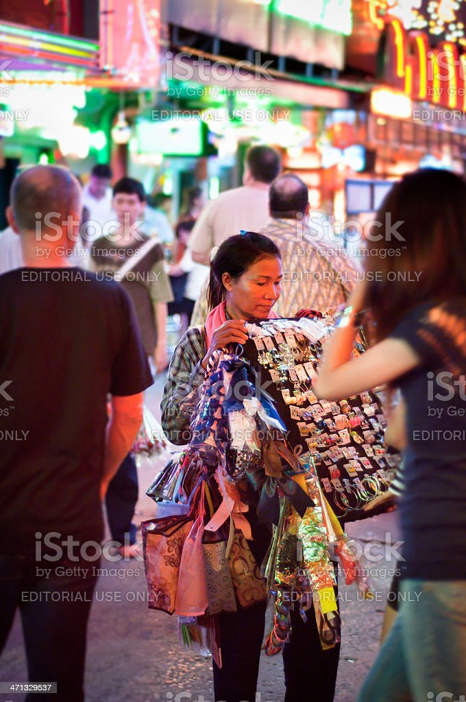 Thai Woman Selling Souvenirs In Soi Cowboy, Bangkok stock photo