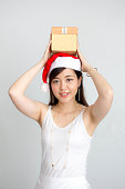 thai women adult beautiful girl hold gift box in hands