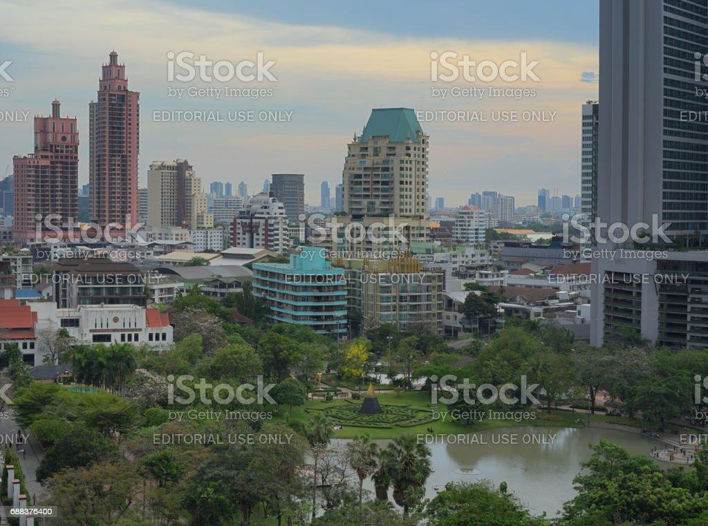 Thailand, Bangkok-April 2017- Benjasiri park during twilight, the green park in the ceter of Bangkok stock photo