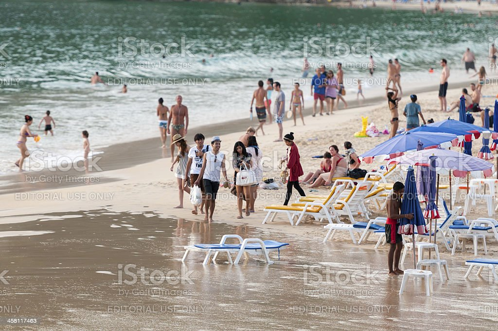 'Thailand, beach: tourists, sunbeds and umbrellas' stock photo