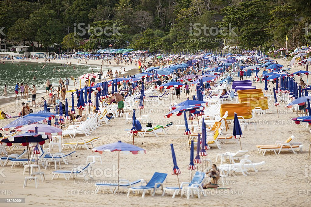 Thailand, beach: tourists, sunbeds and umbrellas stock photo