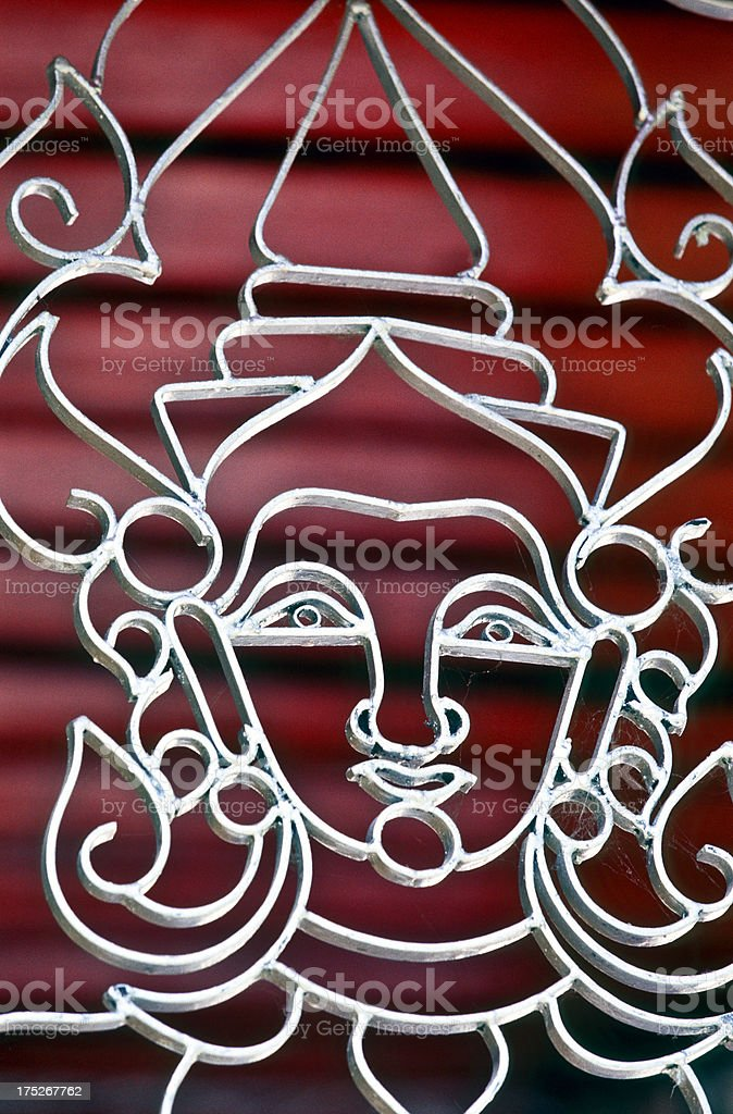 Thailand, Chiang Mai, anthropomorphic face in metal fence. royalty-free stock photo