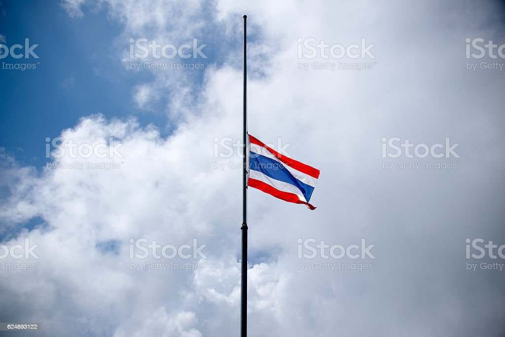 Thailand flag half-mast on pole to mourn stock photo