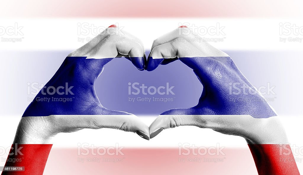 Thailand flag over heart-shaped human hands on isolated background stock photo
