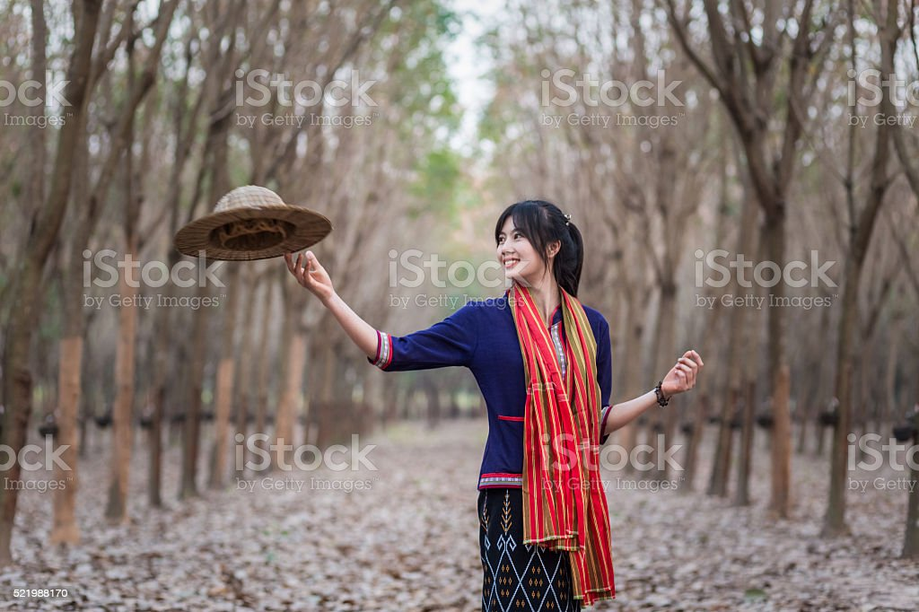 Thailand girl with traditional costumes and throwing a conical hat stock photo