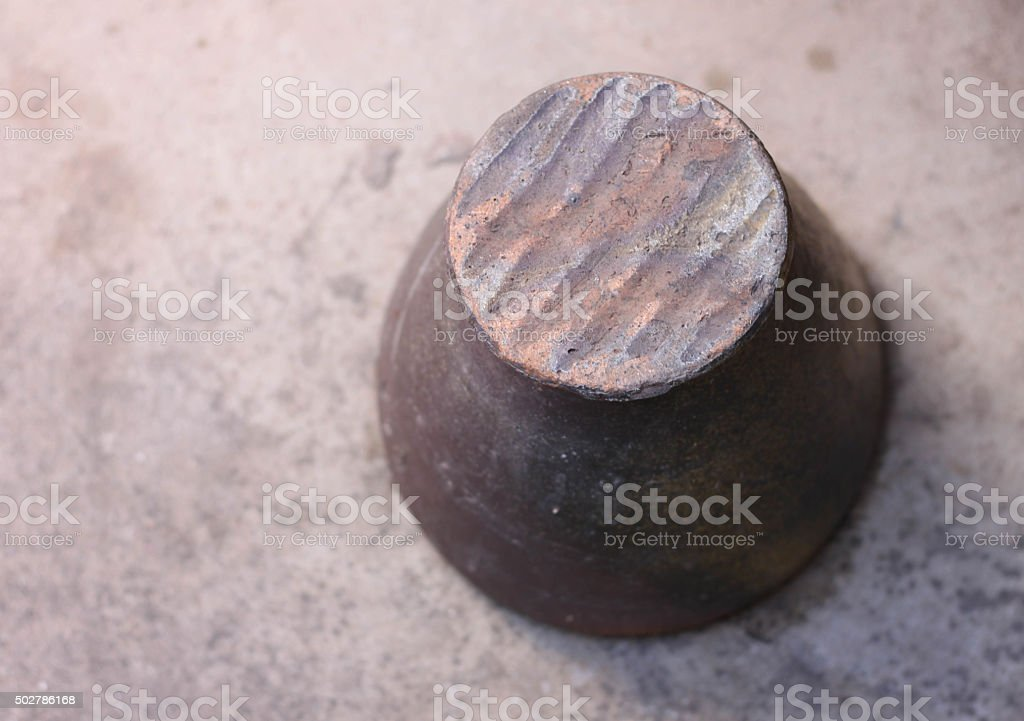 Thailand mortar pepper brown background. stock photo