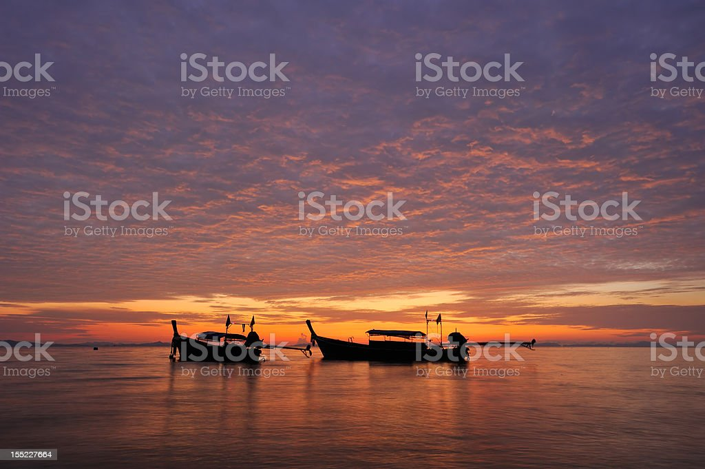 Thailand. PhiPhi island. Magic colorful  sunrise landscape with thai boats royalty-free stock photo