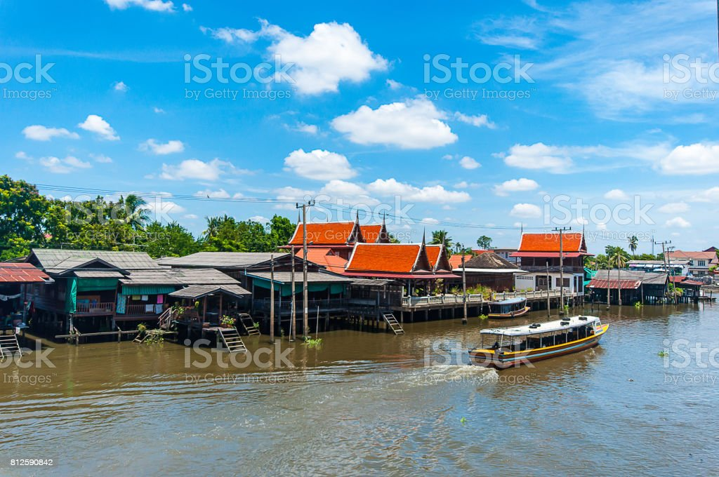 Thailand Taxi Boat in the Canal with Blue Sky stock photo