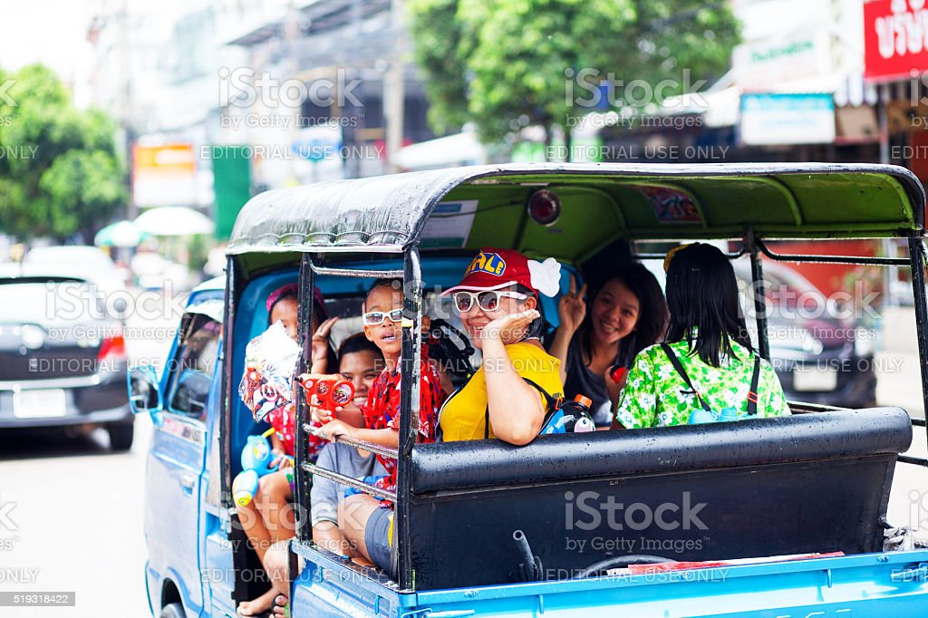 Thais in tuktuk at Songkran stock photo