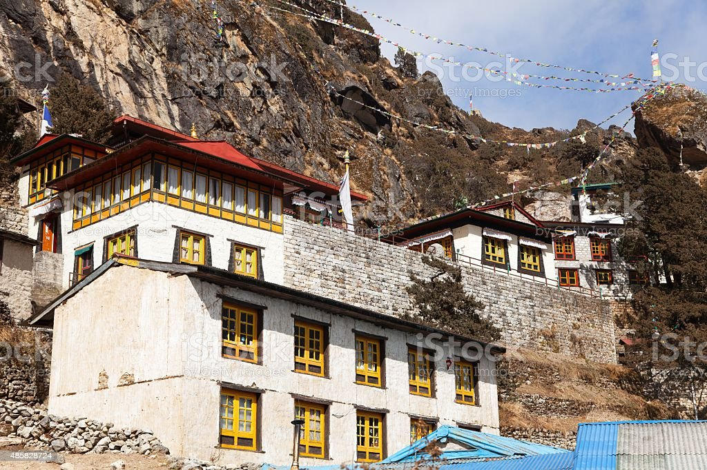 Thame gompa with prayer flags stock photo