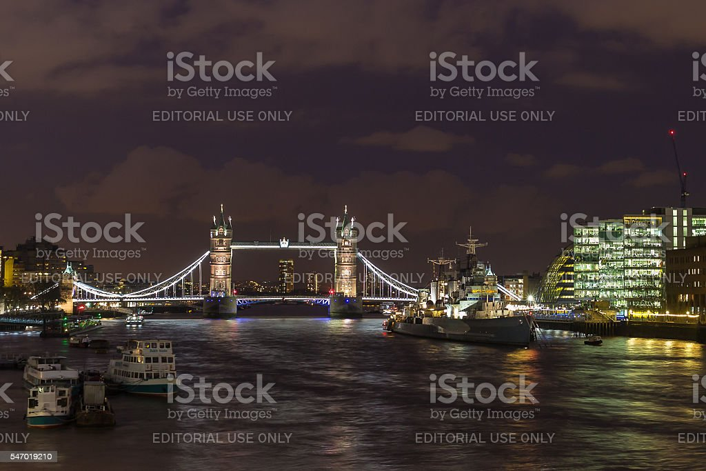 Thames river at night with Tower Bridge and HMS Belfast stock photo
