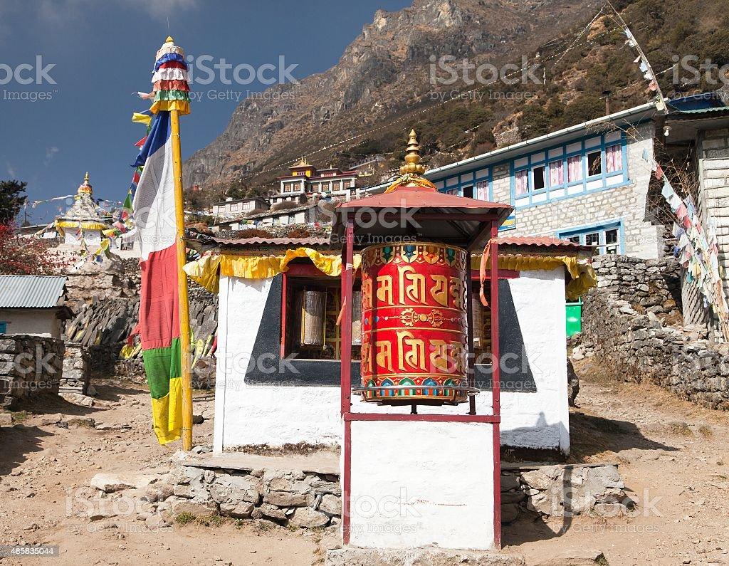 Thamo gompa with prayer flags and buddhist symbols stock photo