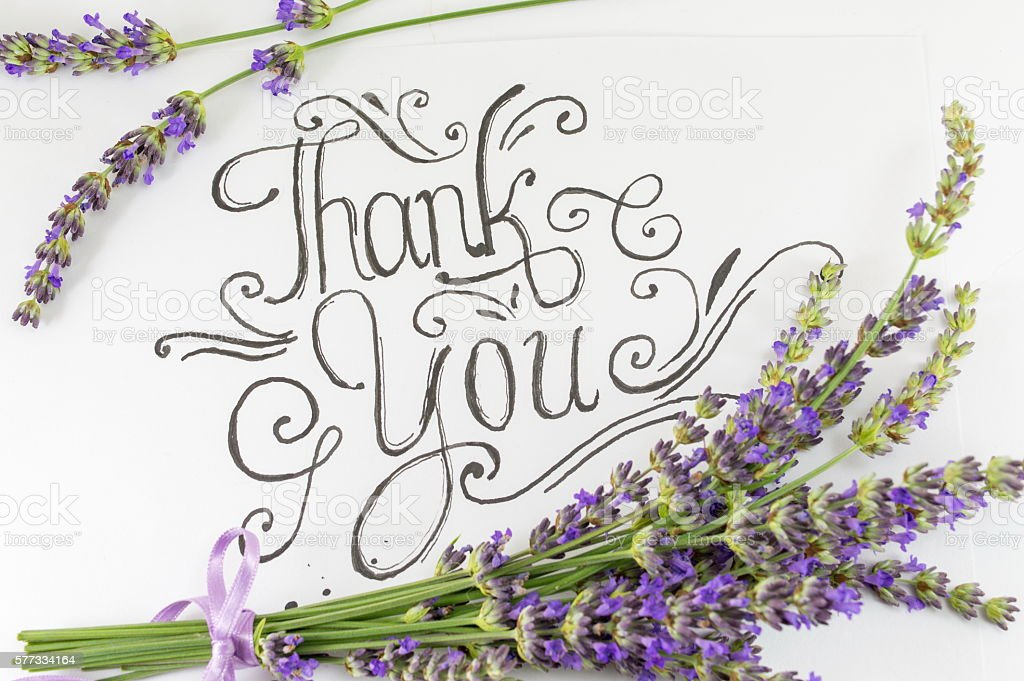 Thank you card with levander flowers on table stock photo