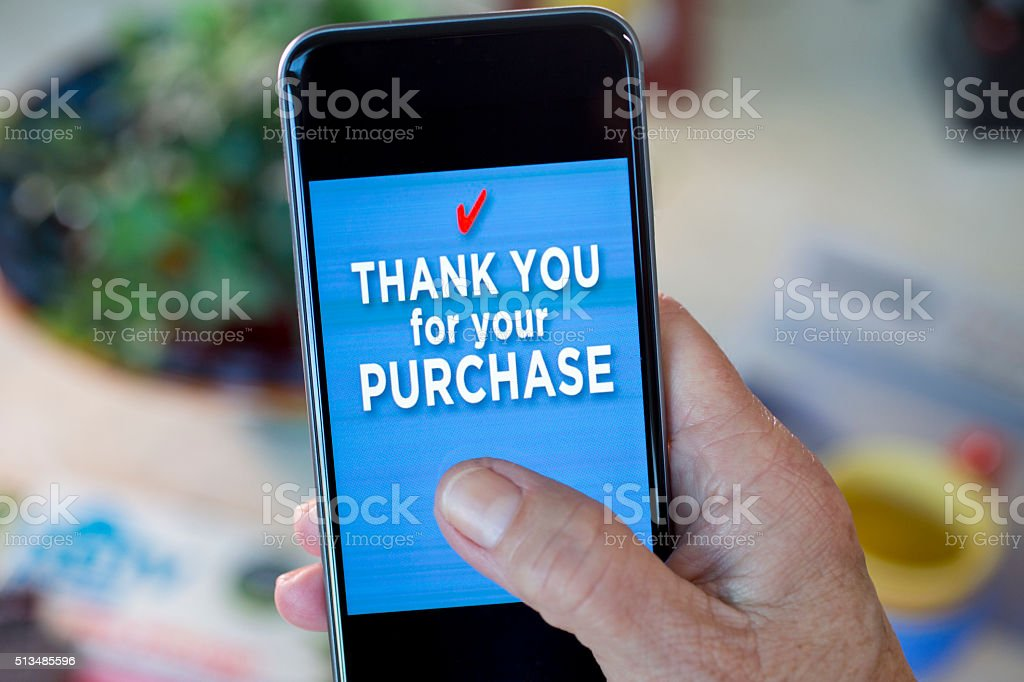 Thank you for your purchase on a cell phone screen stock photo
