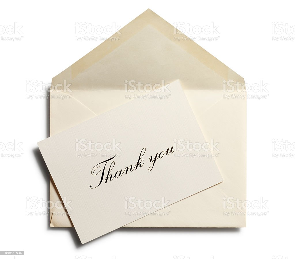 Thank you note against an open envelope isolated stock photo