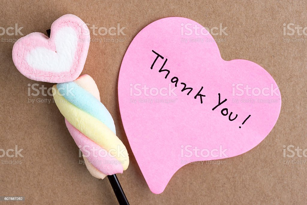 Thank you note in heart shape paper with pink flowers stock photo
