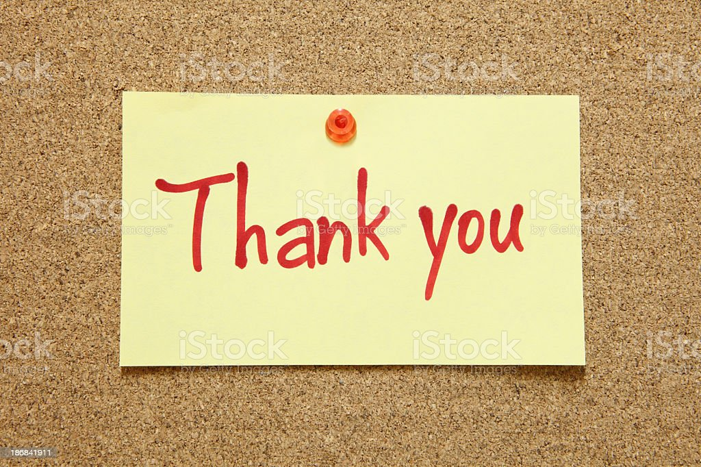Thank you note tacked to a cork board royalty-free stock photo