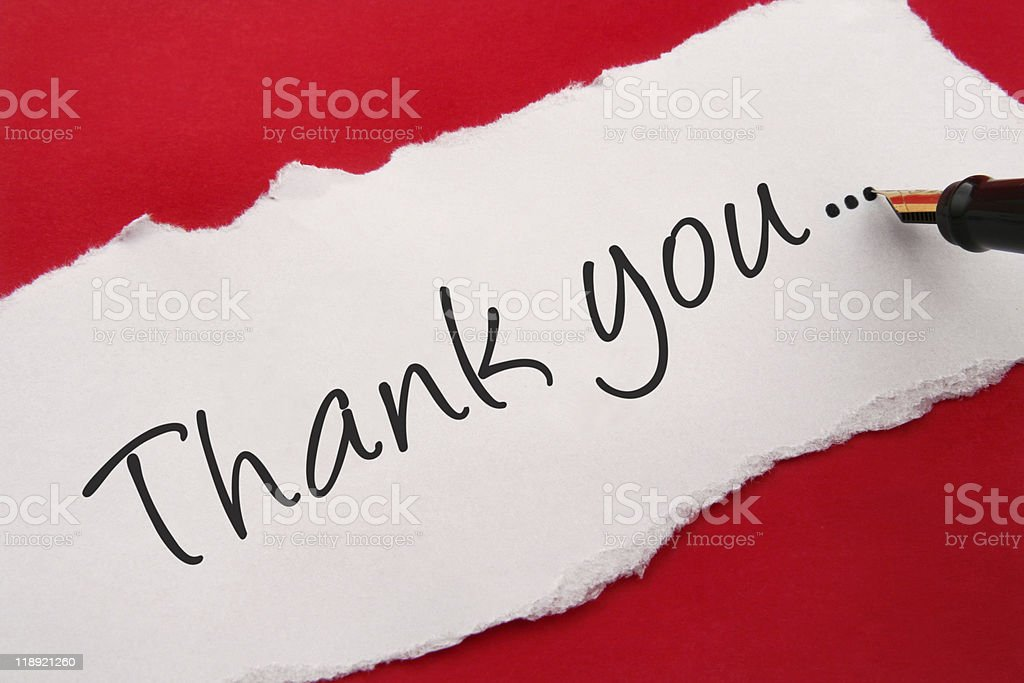 A thank you note written on white torn paper stock photo