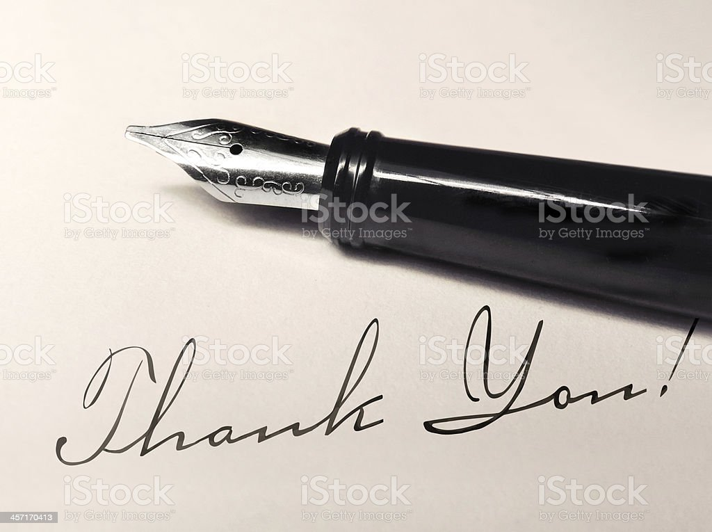 Thank you note written with calligraphy pen stock photo