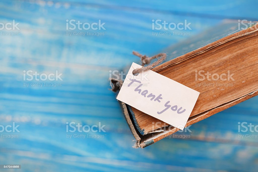 Thank you sign on old book - vintage style stock photo