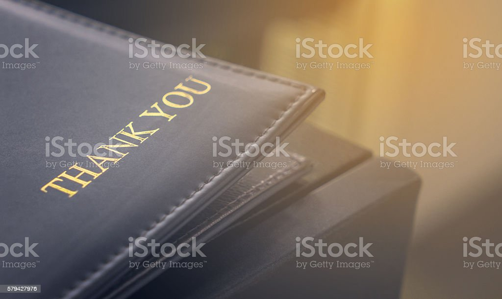 Thank you text on restaurant credit card tray stock photo