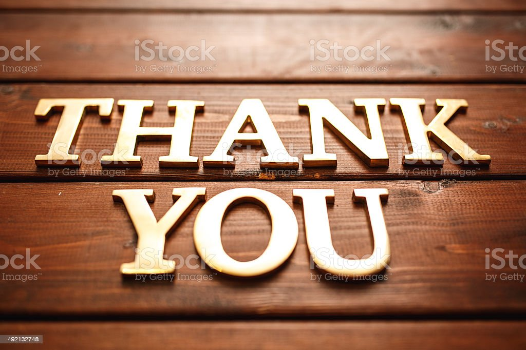 Thank you text on wooden background stock photo