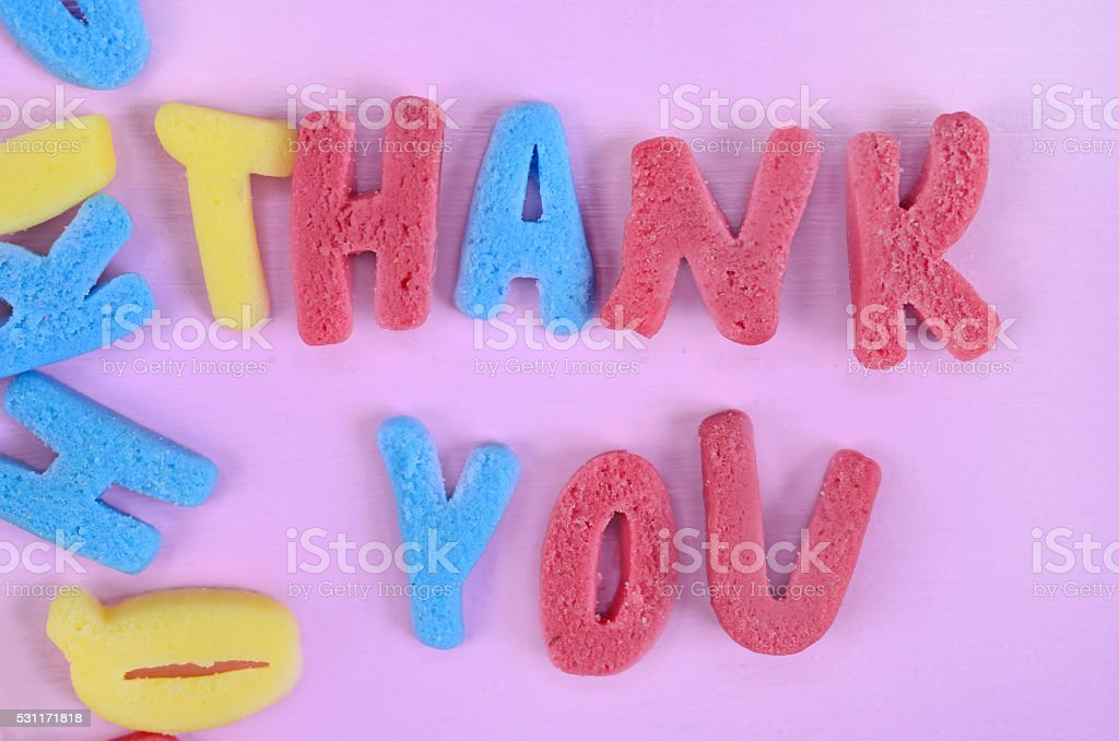 Thank You words on pink table stock photo