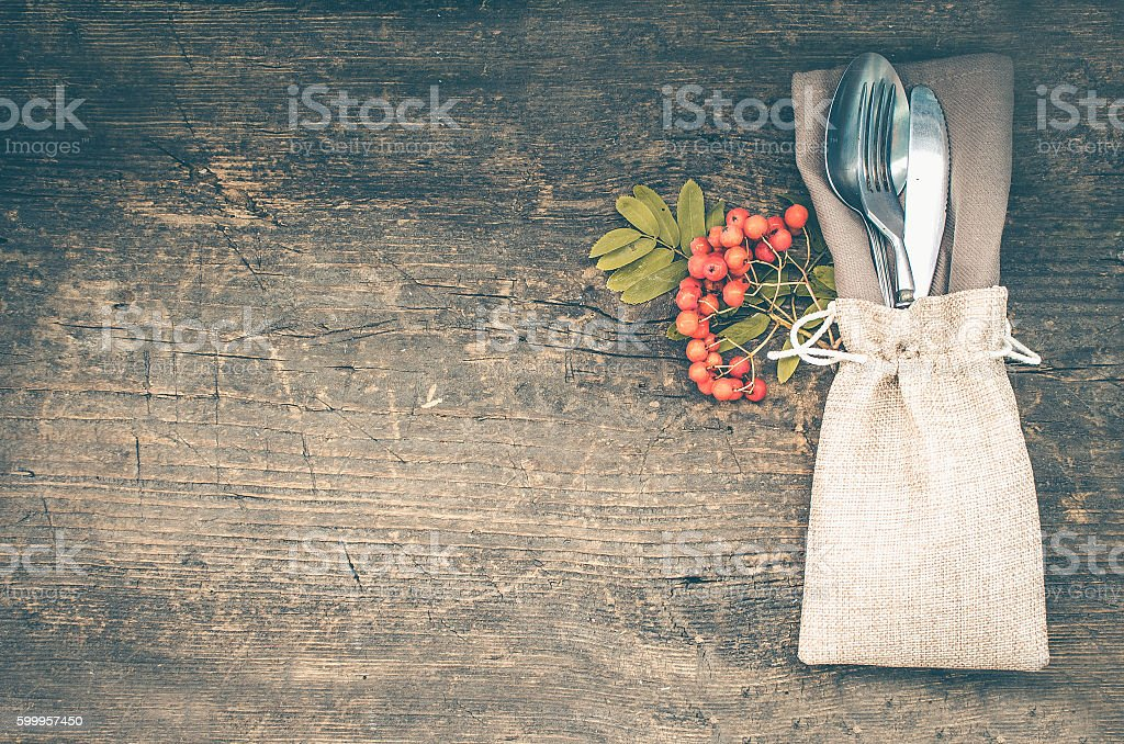 Thanksgiving autumn place setting with cutlery stock photo